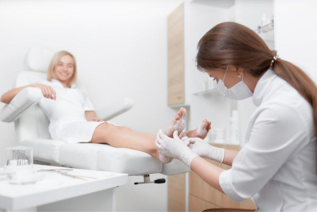 Podiatrist female doctor making procedure of massage and peeling feet, Blowes Podiatry, Podiatry clinic, podiatrist, foot specialist, foot clinic, Westbury, Warminster, Trowbridge