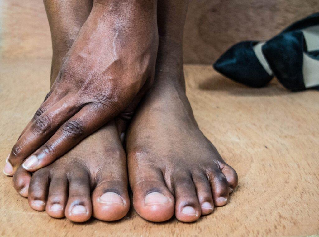 Hand on two feet, Kay Blowes Podiatry, Podiatry clinic, podiatrist, foot specialist, foot clinic, Westbury, Warminster, Trowbridge