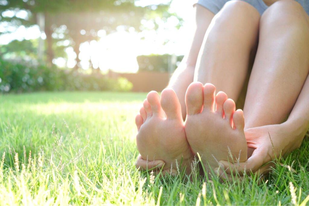 rubbing bottom of feet on the grass, Kay Blowes Podiatry, Podiatry clinic, podiatrist, foot specialist, foot clinic, Westbury, Warminster, Trowbridge